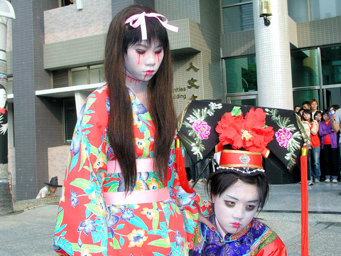 students dress up as chinese and japanese ghosts during a ghost contest at cheng shiu university the kaohsiung county school held the contest on thursday