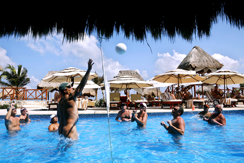 Guests Play A Game Of Volleyball At Hidden Beach Resort In Cancun Mexico May