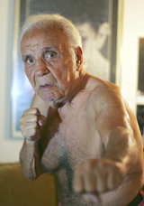 Former middleweight boxing champion Jake LaMotta poses in New York on Wednesday. - P19-091031-335