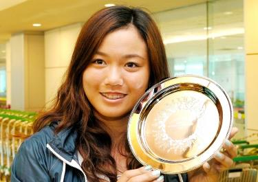 Chan Yung-jan holds up her Australian Open mixed doubles runner's up