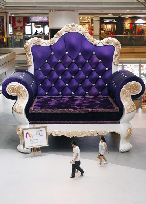 Awesome People Walk Pass A 6.8m By 7.7m Sofa At A Shopping Mall In Shanghai, China,  Yesterday. The Sofa Has Been Approved As The Biggest Sofa Chair In The World  By ...