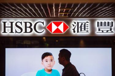 HSBC to buy back shares  after profit plummets 29% - Taipei Times