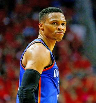3d16e40bb3b Russell Westbrook of the Oklahoma City Thunder reacts after sinking a three- point shot during Game 5 of their NBA Western Conference series against the  ...