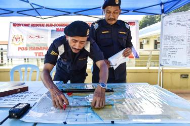 Malaysian Maritime Enforcement Agency Officials In Tanjung Pengelih Yesterday Mark Out A Grid Off The Coast Of Johor On A Map For A Search And Rescue