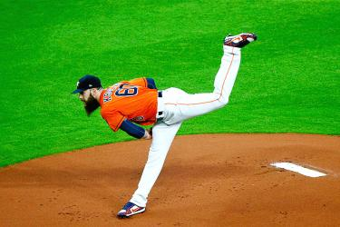Keuchel fans 10, as the Astros clip the Yankees