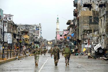 Duterte declares Marawi liberated as battle goes on