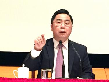 Chinese official threatens forced unity