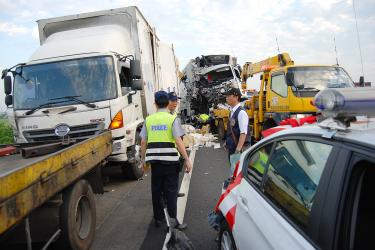 Collision kills policemen, trucker