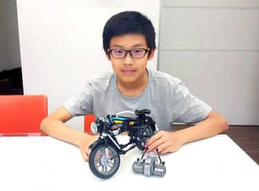 Lego reviewing teenager's model of BMW motorcycle