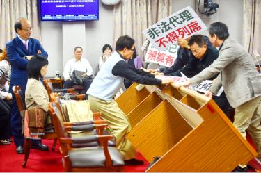 KMT members disrupt Transitional Justice review