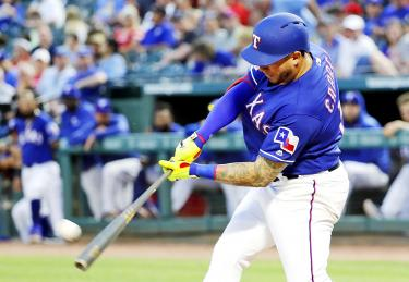 Rangers hit five homers, hold off Mariners