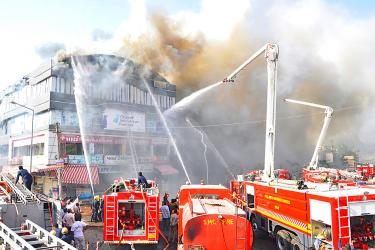 At least 20 die in India school fire; owners charged
