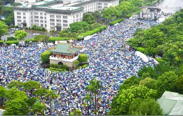 Thousands protest pro-China media