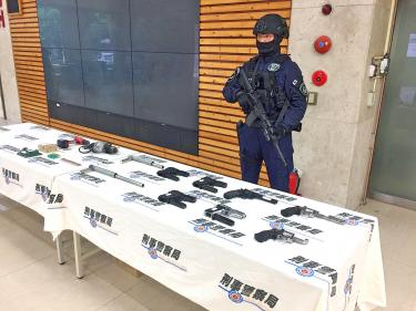 Police tout results of raids on gun, loan operations