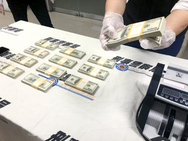 Two detained over alleged link to counterfeit money
