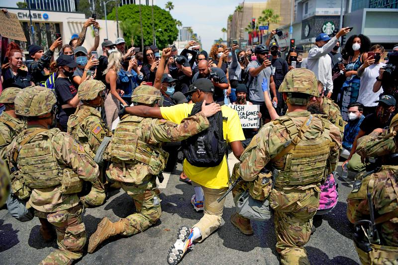 Racial Tensions: Police across US taking a knee to support ...