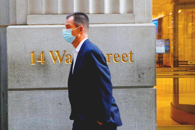 Wall Street closes lower as surging Covid-19 cases offset vaccine hopes