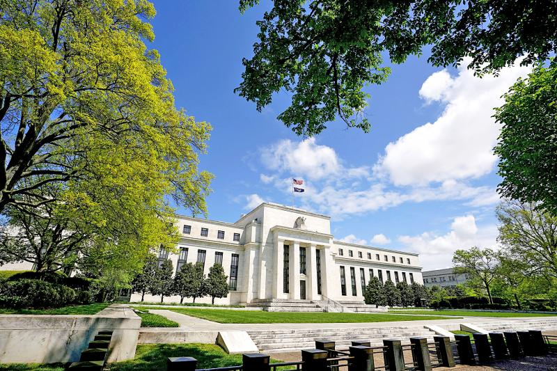 Fed sees more signs of activity slowing in US