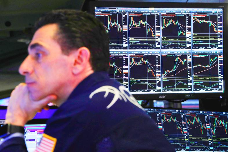 Dow Jones falls, but set for strong yearly gains